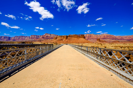 Scenic Navajo pedestrian bridge over the Colorado River in Arizona. Stock Photo