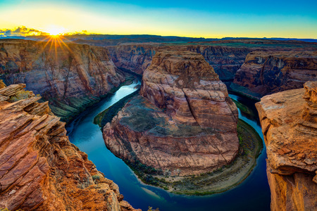 The beautiful Horseshoe Bend and Colorado River at sunset in Arizona. Stok Fotoğraf