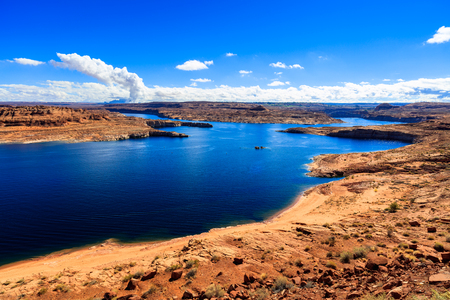 Scenic view of beautiful Lake Powell in Utah with the Glen Canyon Dam in the background. Stock Photo