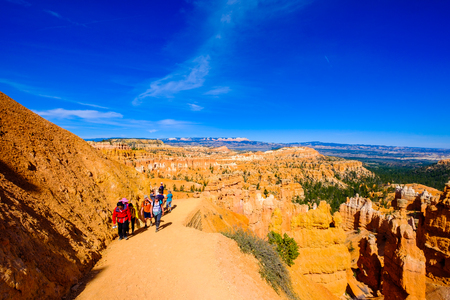 Bryce Canyon, Utah USA - April 22, 2017: Visitors enjoying a hiking trail along the natural beauty of the Amphitheater in Bryce Canyon National Park.