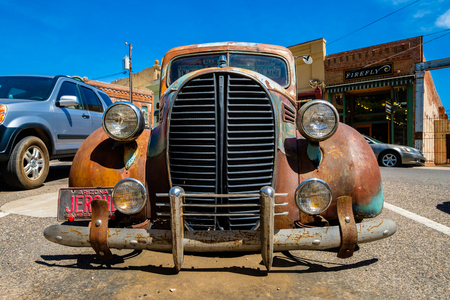 Jerome, Arizona USA - April 27, 2017: Close up view of the front of a vintage pick up truck in the downtown area of this popular small mountain town located in Yavapai County.