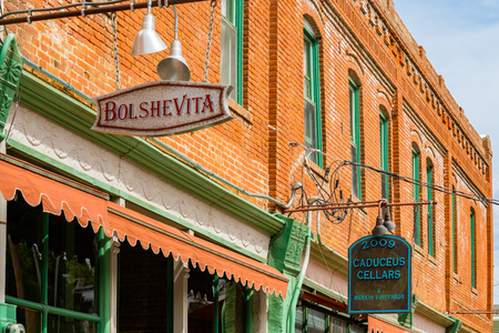 city and county building: Jerome, Arizona USA - April 27, 2017: Cityscape view of the downtown signage of this popular small mountain town located in Yavapai County in the Verde Valley.