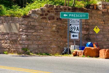 Jerome, Arizona USA - April 27, 2017: Road signs leading to Prescott from this popular small mountain town located in Yavapai County in the Verde Valley.