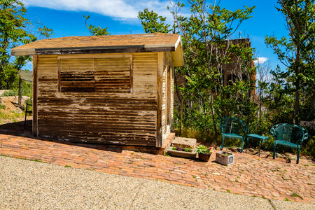 city and county building: Jerome, Arizona USA - April 27, 2017: Vacant wooden retail store shack in the downtown area of this popular small mountain town located in Yavapai County in the Verde Valley.