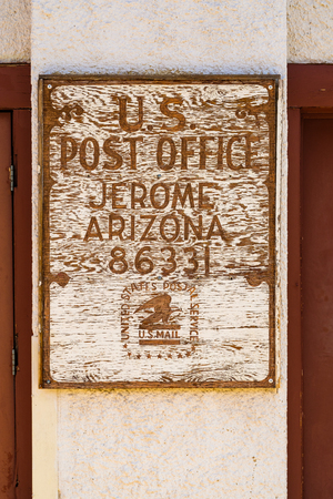 Jerome, Arizona USA - April 27, 2017: Vintage wooden United States Post Office sign in this popular small mountain town located in Yavapai County in the Verde Valley.