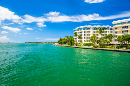 Scenic Miami Beach cityscape view of Belle Isle with condos on the Venetian Causeway along the bay. Stock Photo