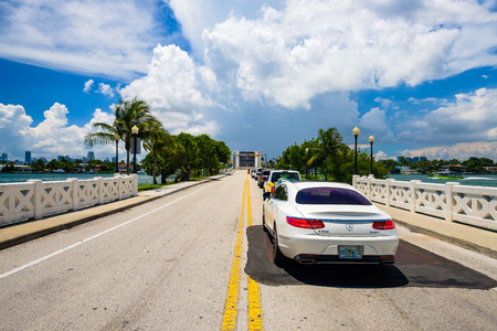 Miami Beach, Florida - August 14, 2017: Scenic Miami Beach cityscape view of the Venetian Causeway and open drawbridge with cars waiting for a boat to pass.