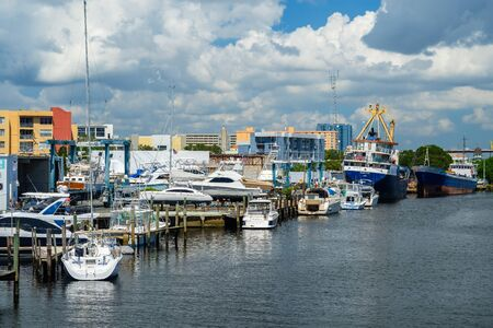 Miami, Florida - August 16, 2017: Scenic Miami River cityscape with marinas and boatyards along the Northwest Fifth Street drawbridge.