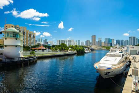docked: Miami, Florida - August 16, 2017: Scenic Miami River cityscape with luxury yachts docked along the Northwest Fifth Street drawbridge.