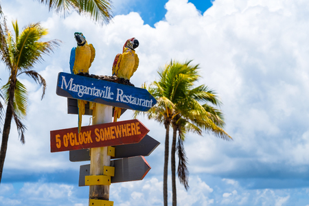 Hollywood Beach, Florida - July 6, 2017: Cityscape view of the colorful signs for the Margaritaville Resort, a popular tourist destination in Broward County. Редакционное