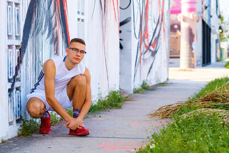 Handsome young man portrait in a urban setting.