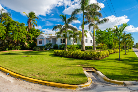 estate: Naples, Florida - November 1, 2017: Classic architecture style home in the historic coastal gulf residential district of Old Naples.