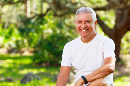Handsome middle age man outdoor portrait in a park setting. Stock Photo