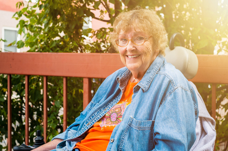 Pretty senior handicap woman outdoor portrait. Stock Photo