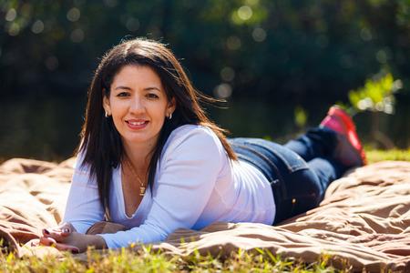 Beautiful middle age hispanic woman outdoor portrait.