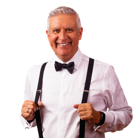 Handsome middle age man with bow tie and suspenders on a white background. Stockfoto