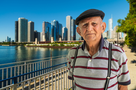 Elderly 80 plus year old man outdoor portrait with the Chicago skyline in the background. Stock Photo