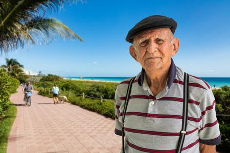Elderly 80 plus year old man outdoor portrait enjoying Miami Beach. Stock Photo