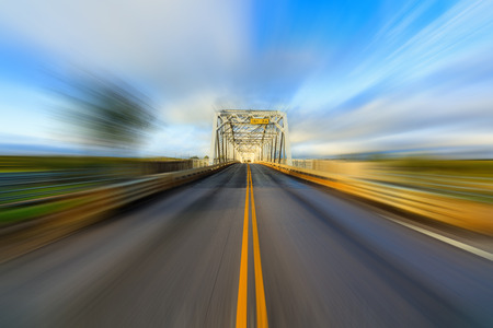 The historic Llano River Bridge located in the Texas hill country with motion blur. Stock Photo