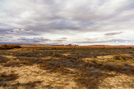 Rural desert landscape on a cloudy day between the Arizona and Utah border.