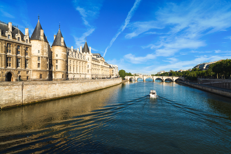 The historic River Seine in Paris, France with a boat cruising by. Stock fotó