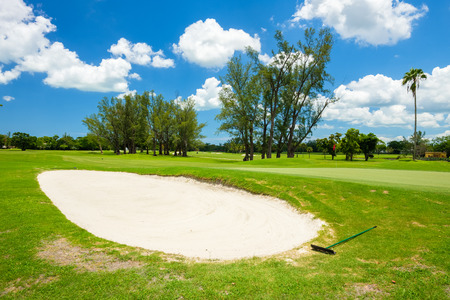 South Florida golf course landscape viewed from behind the sand trap. Stock Photo