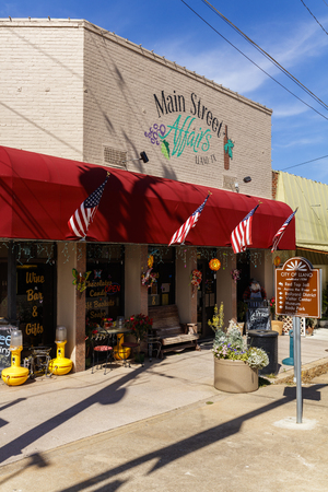 Llano, Texas USA - April 5, 2016: Scenic cityscape view of Main Street in the small Texas Hill Country town of LLano. Editorial