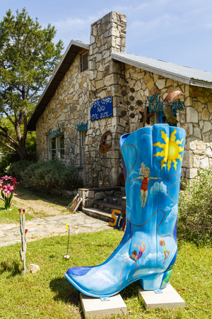 Wimberley, Texas USA - April 6, 2016: Colorful boot art sculpture on display in the small Texas Hill Country town of Wimberley. Editorial