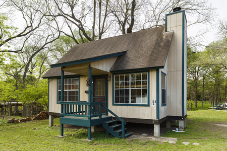 Wimberley, Texas USA - April 6, 2016: Tiny cottage wood frame home in this small rustic town in the Texas Hill Country.