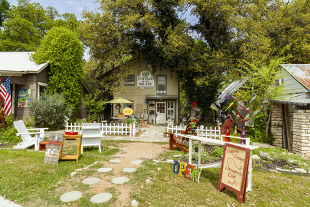Wimberley, Texas USA - April 6, 2016: Colorful shops with artwork on display in the small Texas Hill Country town of Wimberley.