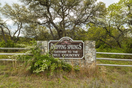 Dripping Springs, Texas USA - April 6, 2016: Welcome to Dripping Springs sign from this small town in the Texas Hill Country.