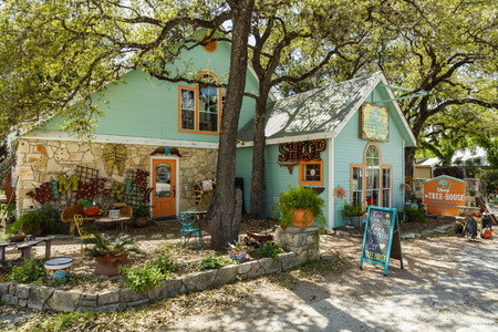 Wimberley, Texas USA - April 6, 2016: Colorful shop with artwork on display in the small Texas Hill Country town of Wimberley. Editorial