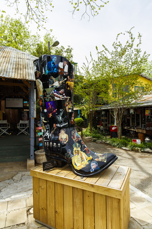 Wimberley, Texas USA - April 6, 2016: Colorful shop with artwork and vintage items on display in the small Texas Hill Country town of Wimberley.