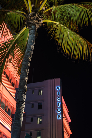 Miami Beach, Florida USA - February 28, 2019: Night cityscape view of the classic art deco hotel architecture with neon lights on popular Ocean Drive. Editorial