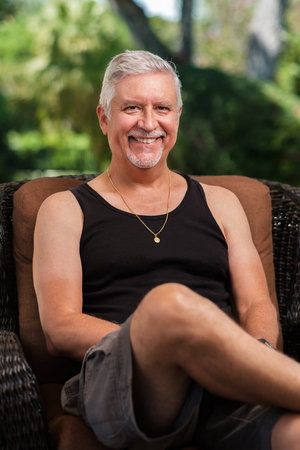 Handsome middle age man outdoor portrait in a home patio setting.