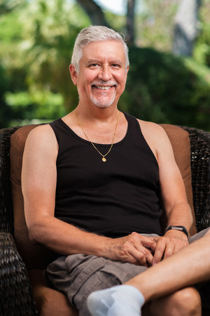 Handsome middle age man outdoor portrait in a home patio setting. 写真素材 - 119431832