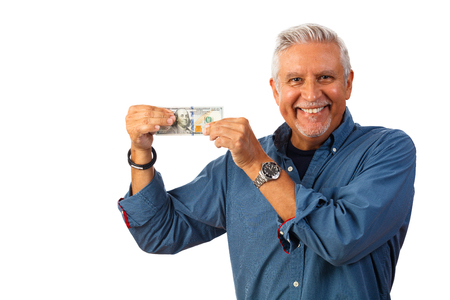Handsome middle age man studio portrait holding a one hundred dollar bill isolated on a white background.