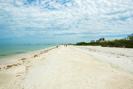 Pretty Fort Myers Beach on the west coast of Florida on a cloudy day.