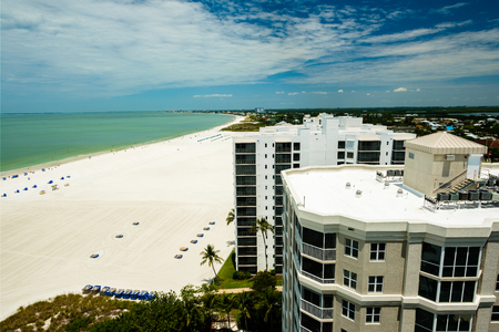 Penthouse view from pretty Fort Myers Beach on the west coast of Florida on a cloudy day.