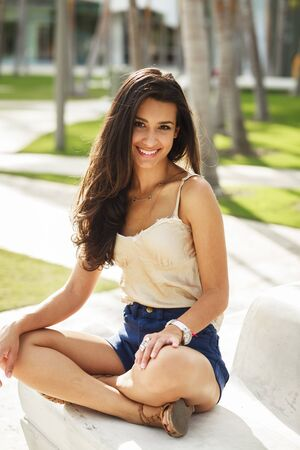 Beautiful young multiracial woman outdoor portrait.