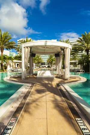 Miami Beach, Florida USA - October 3, 2012: The beautiful pool area of the historic art deco style Fontainebleau Hotel designed in the 1950s.