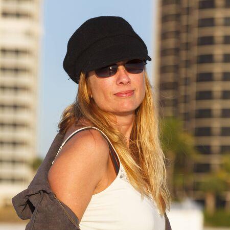 Beautiful middle age woman outdoor portrait. 免版税图像