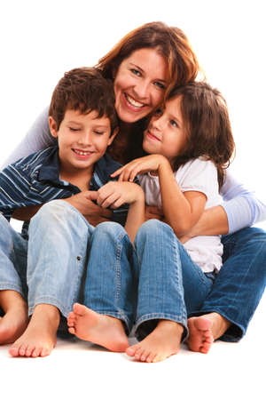 Pretty young mother, son and daughter portrait on a white background. Stock fotó