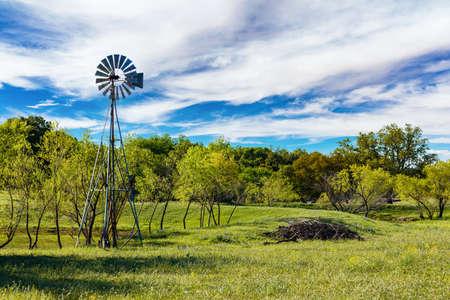 Pretty Texas Hill Country ranch with a windmill. Archivio Fotografico