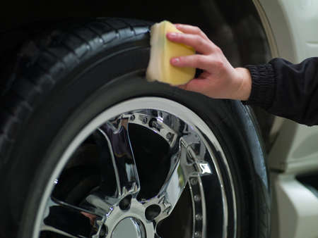 car wheel and hand the men, rubbing tires Stock Photo