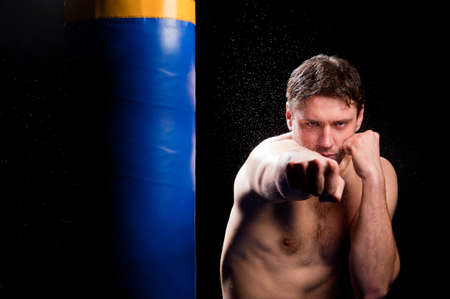 athlete trains with boxing projectile