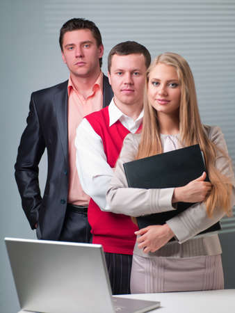 Two men and woman working with a computer in the office Stock Photo