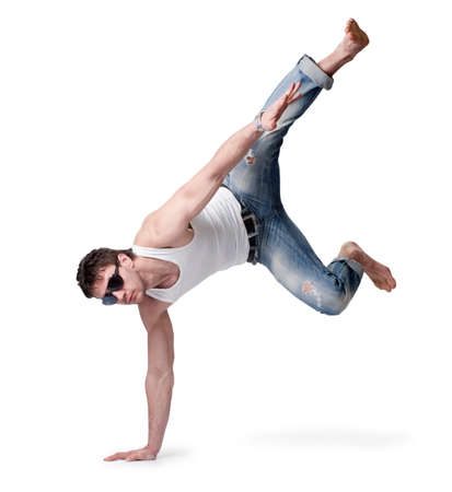 young man in jeans jumping on a white background