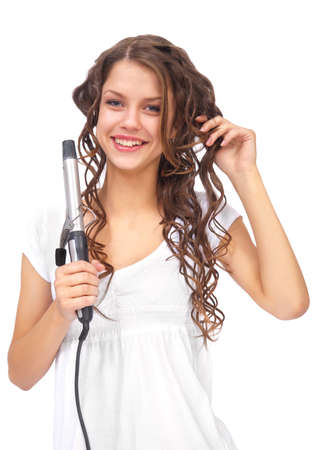 girl with curly hair biting hair dryer Stock Photo - 9482808
