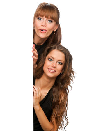 Two women hold in their hands clean poster, isolated background Stock Photo
